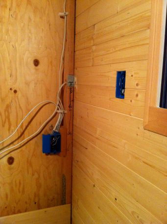 Here is what the switch box by the window looks like once the paneling is up (box on the right).