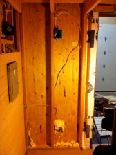 Profile view of the installed breaker box as paneling is being added.
