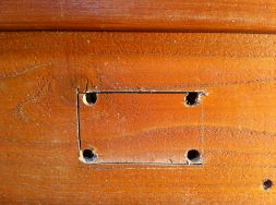 I centered and marked the location on a row of siding, drilled holes at the corners and used a jig saw to cut out the opening. Cutting through the wall of my house for the first time felt like giving a dear friend a tracheotomy.