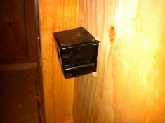 The installed box as seen from the interior. It's canted since it's flush-mounted on bevel siding.